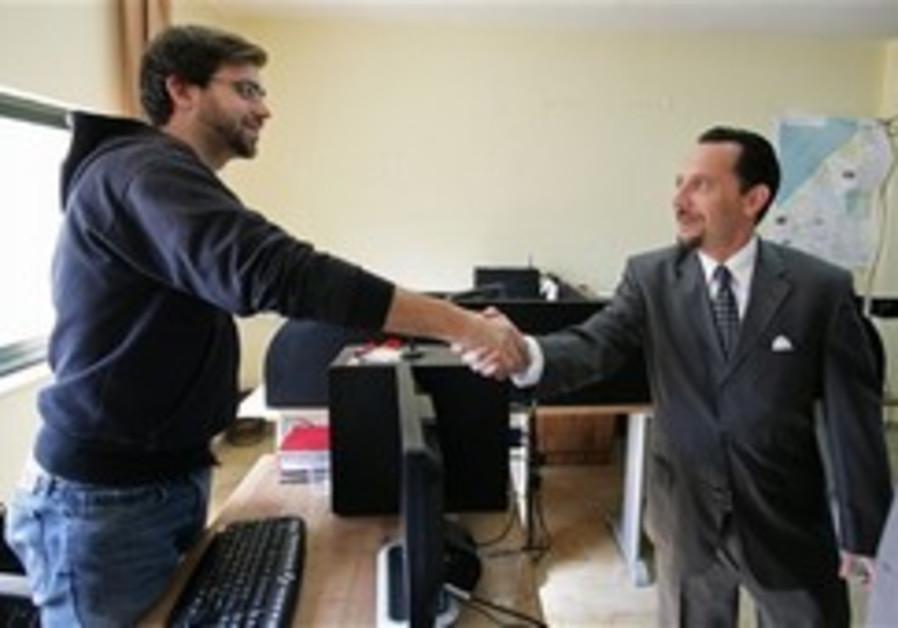American journalist Jared Malsin, left, shakes han