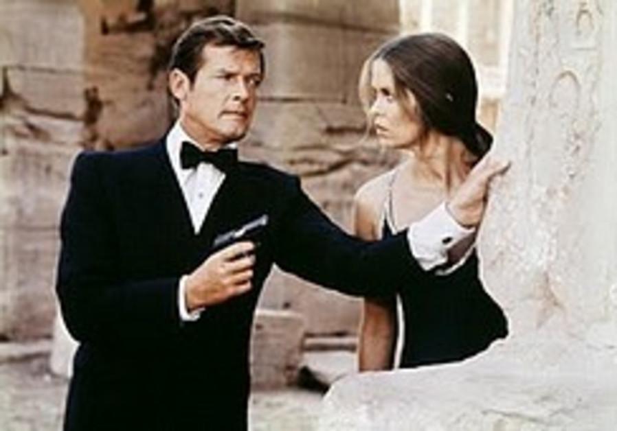 Sir Roger Moore as James Bond.