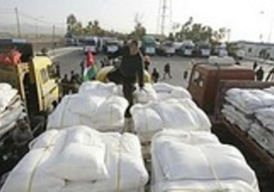A Jordanian driver checks trucks loaded with human