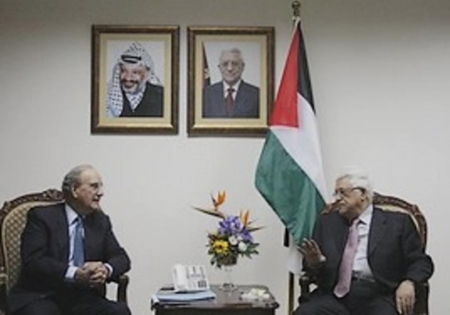 US Middle East envoy George Mitchell, left, talks