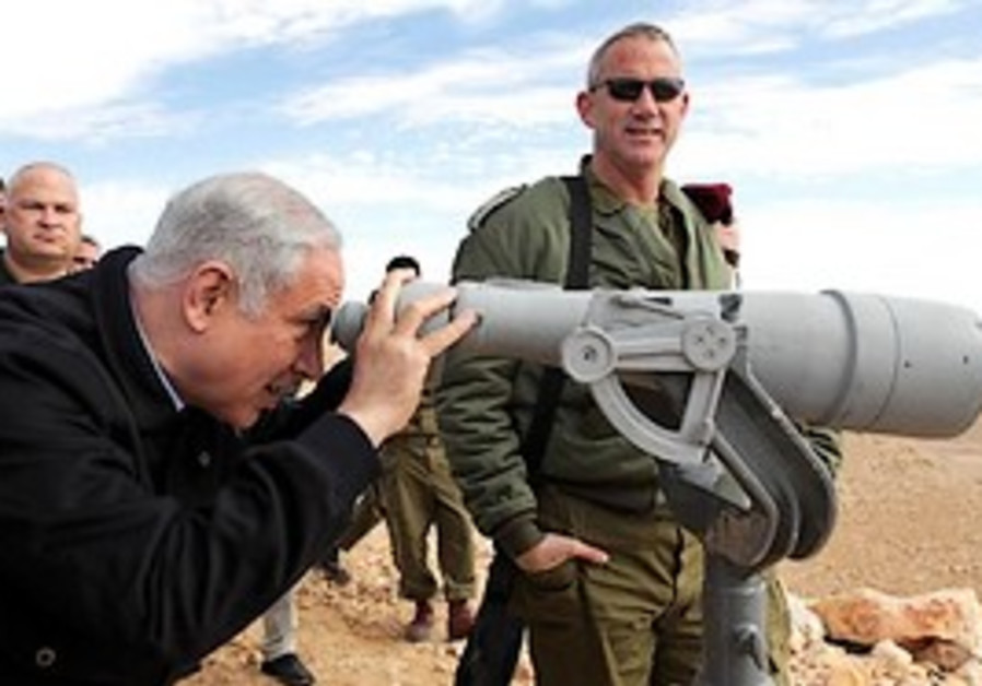 Prime Minister Binyamin Netanyahu looks through a