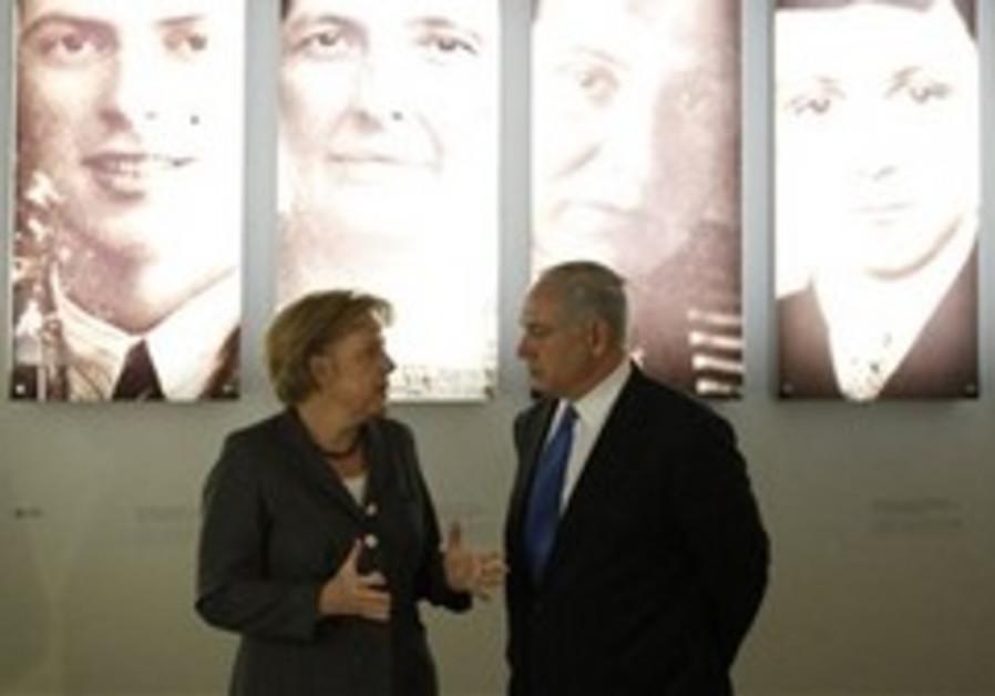 Merkel, PM at Berlin's Holocaust memorial.