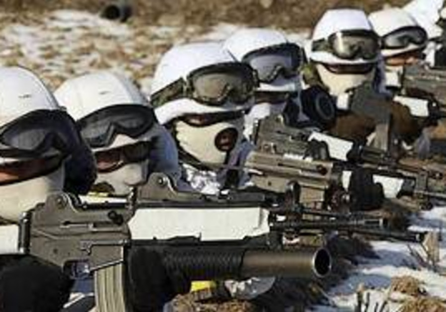 South Korean soldiers aim their machine guns durin