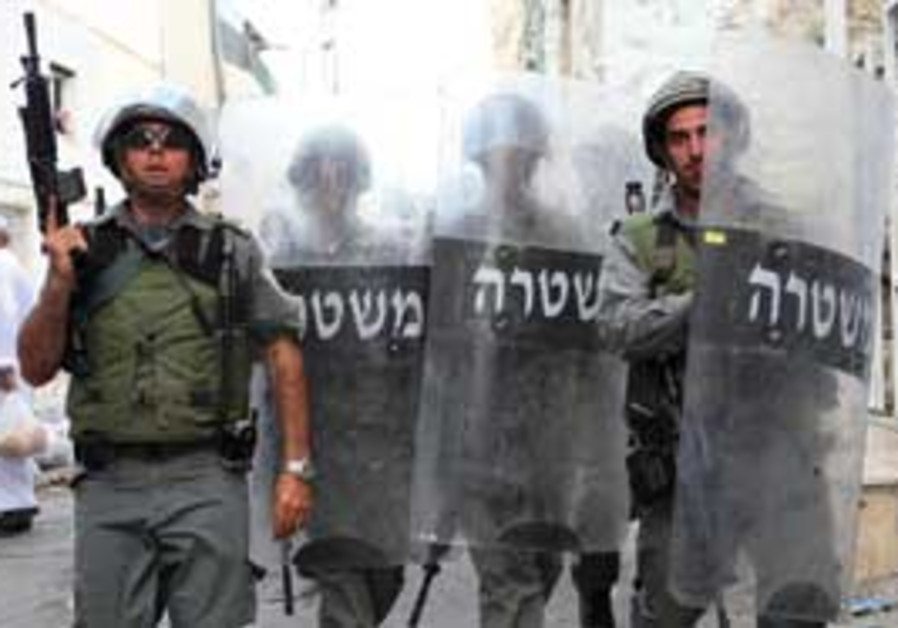 Police tackling unrest in the Old City.