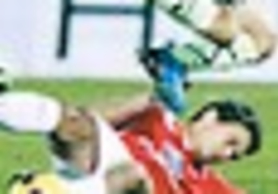 Maccabi Netanya's Gomez tramples Hap TA's Bondar.
