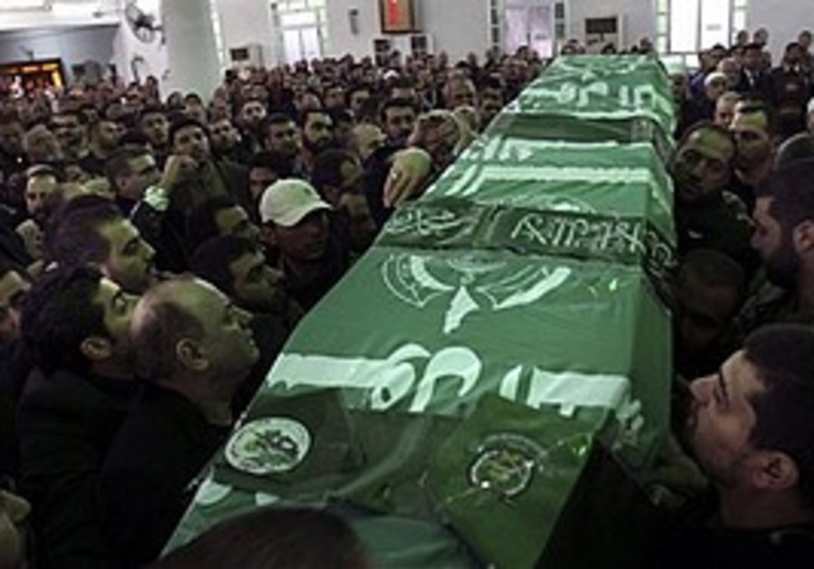 Hamas members carry Mahmoud al-Mabhouh's coffin in