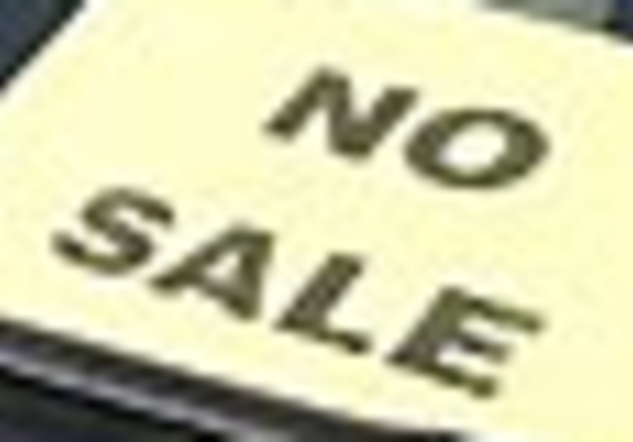 "A ""No Sale"" sign is placed on a used Toyota vehicl"