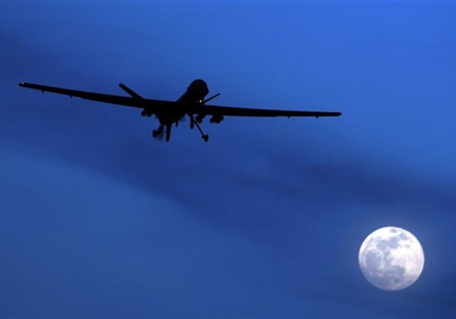 A US Predator drone flies over the moon above Kand