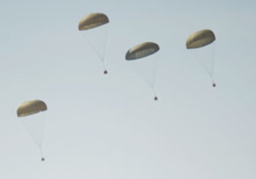 Parachutes carry supplies fly over Israeli militar