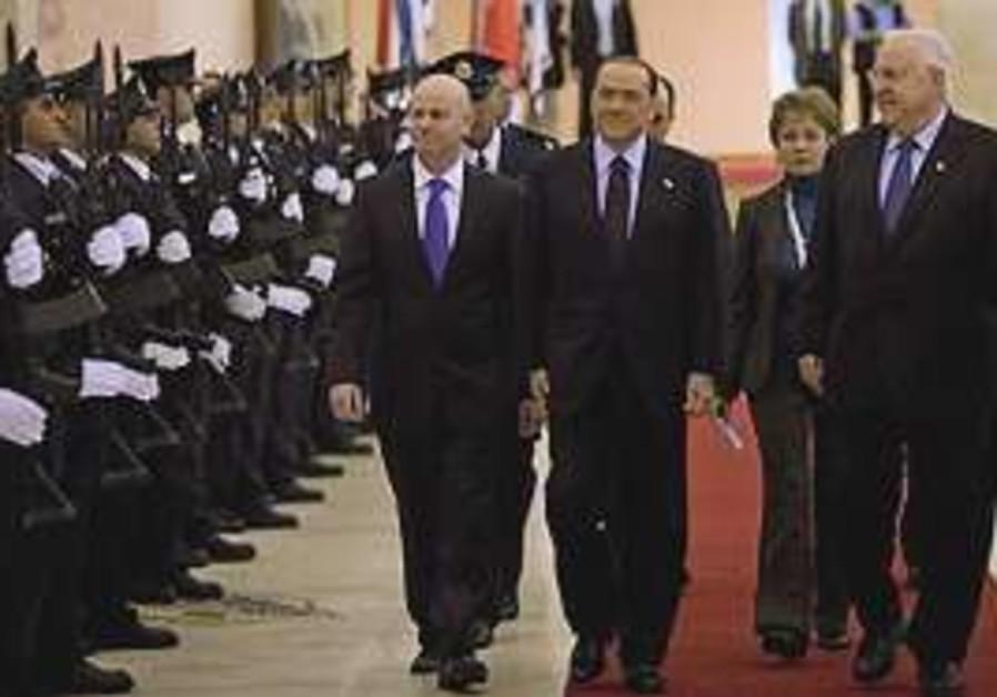 Italian Prime Minister Silvio Berlusconi, center,