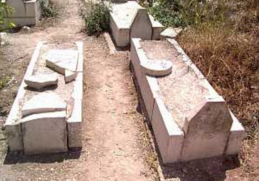 IDF, settlers repair vandalized graves