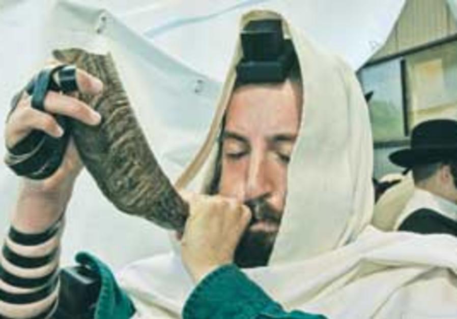 A man blows a shofar at the tomb of Rabbi Nahman o