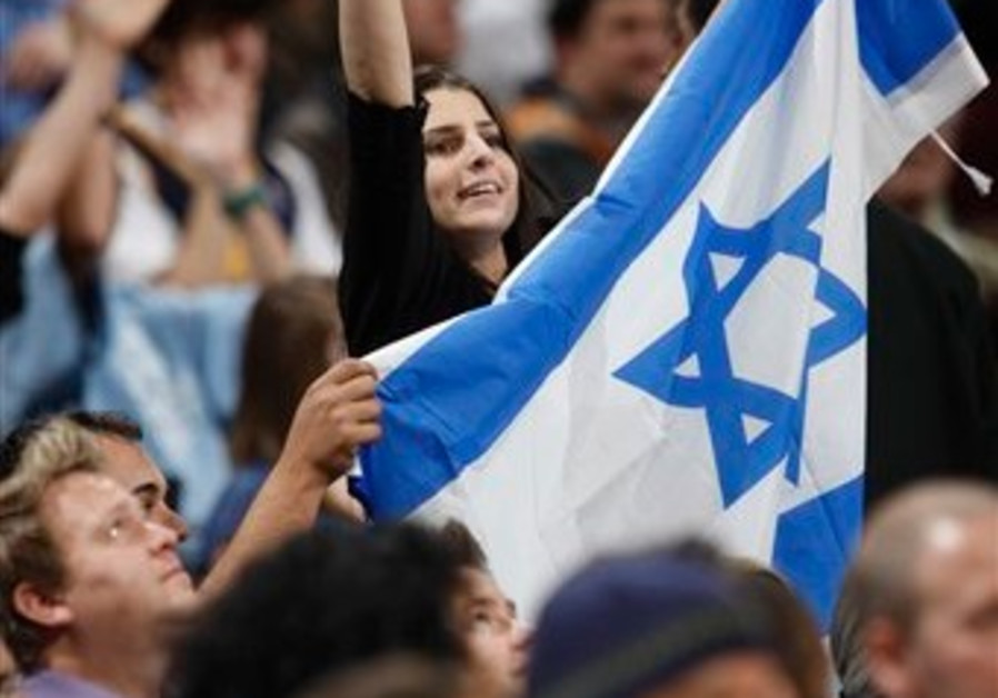 An unidentified fan holds the flag of Israel as sh