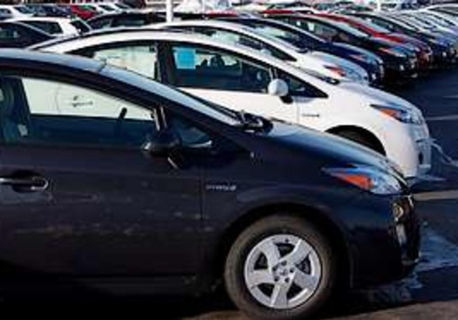 Prius Sedans Sit At A Toyota Dealership In Lakewoo