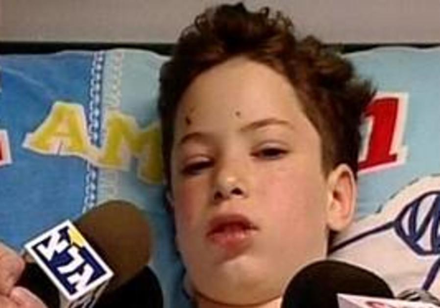 Daniel Yuval speaks to reporters in hospital