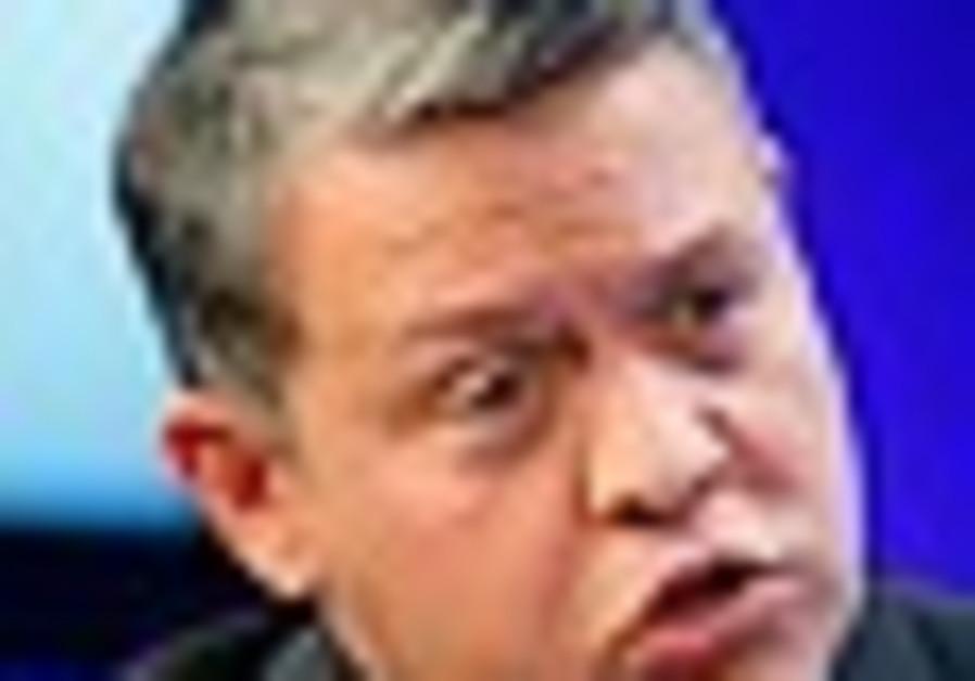 Jordan's King Abdullah gestures while speaking dur