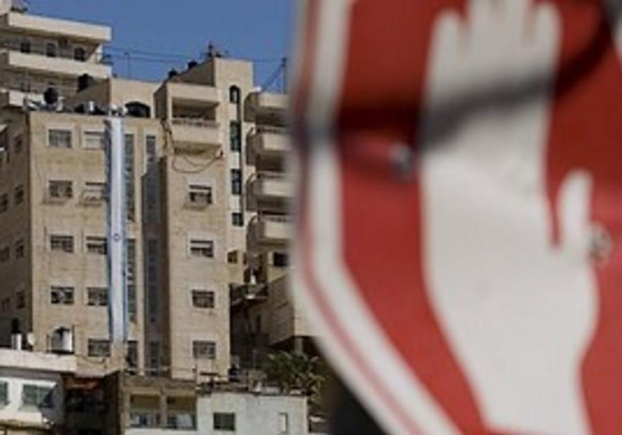 An Israeli flag is seen running down the facade of