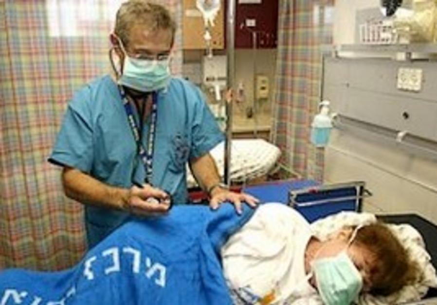 Israeli doctor examines swine flu patient.