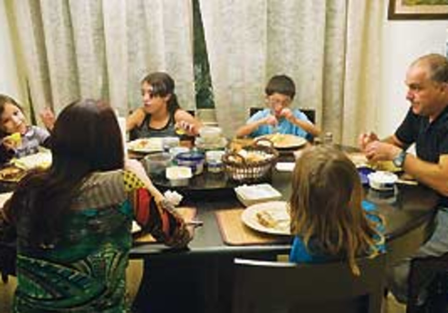 An Israeli family having dinner.