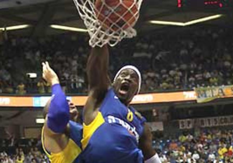 Maccabi TA's Doron Perkin dunks the ball with auth