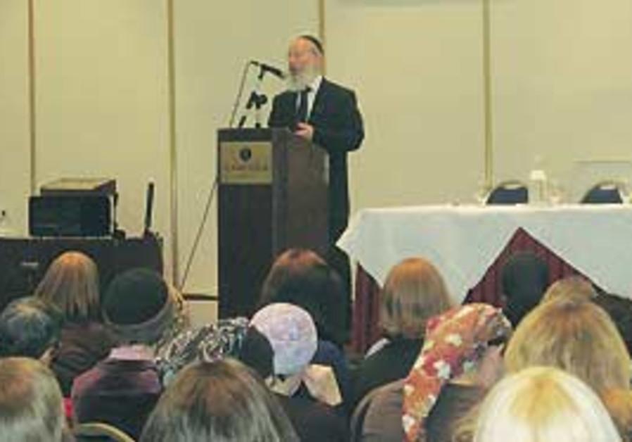 Rabbi Yitzhak Berkovits speaking.