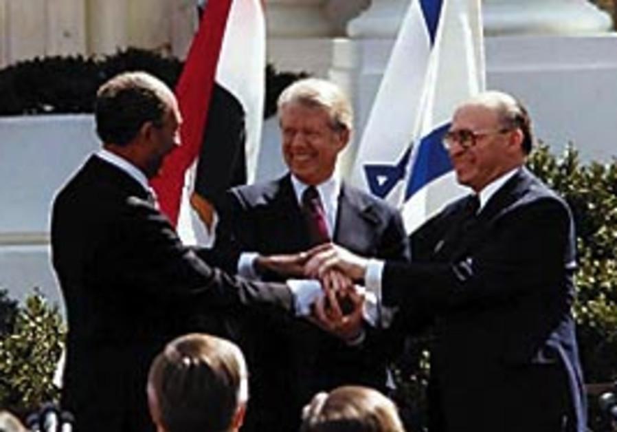 President Jimmy Carter sheks hands with Egyptian P