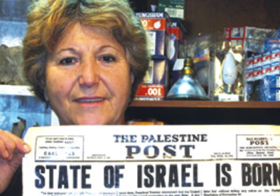 Edna Yemin holds up a photograph of the famous ad.