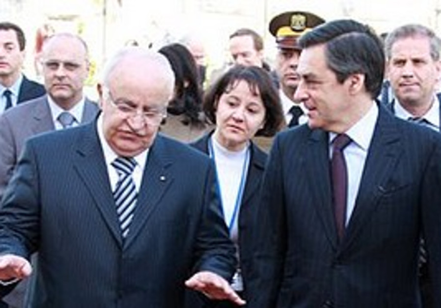 French Prime Minister Francois Fillon,right, and h