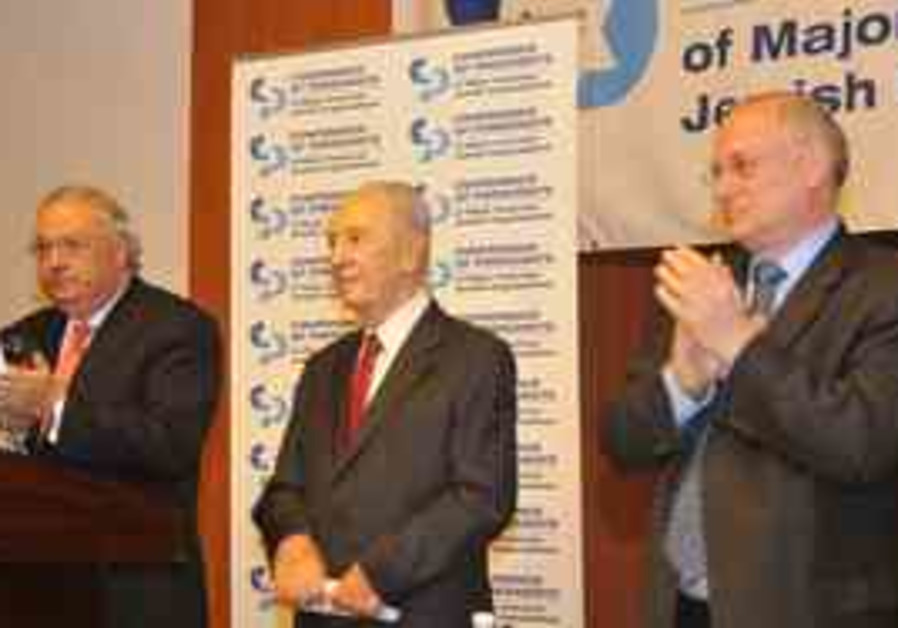 President Shimon Peres speaks to the Conference of