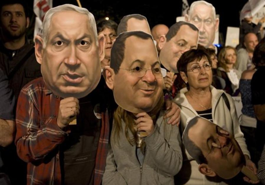 Israeli left-wing activists wearing masks of Prime