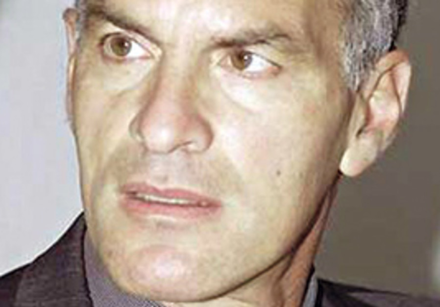 Norman Finkelstein waved a banner during a protest