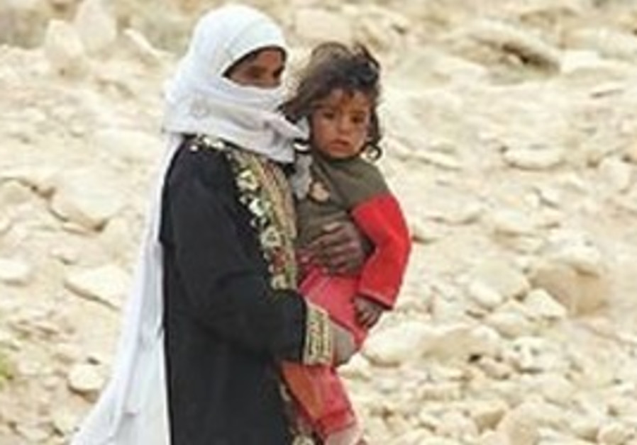 A Beduin woman and child.