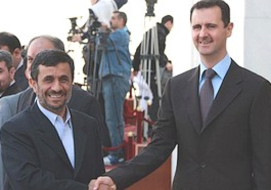Assad meets Ahmadinejad in Damascus.