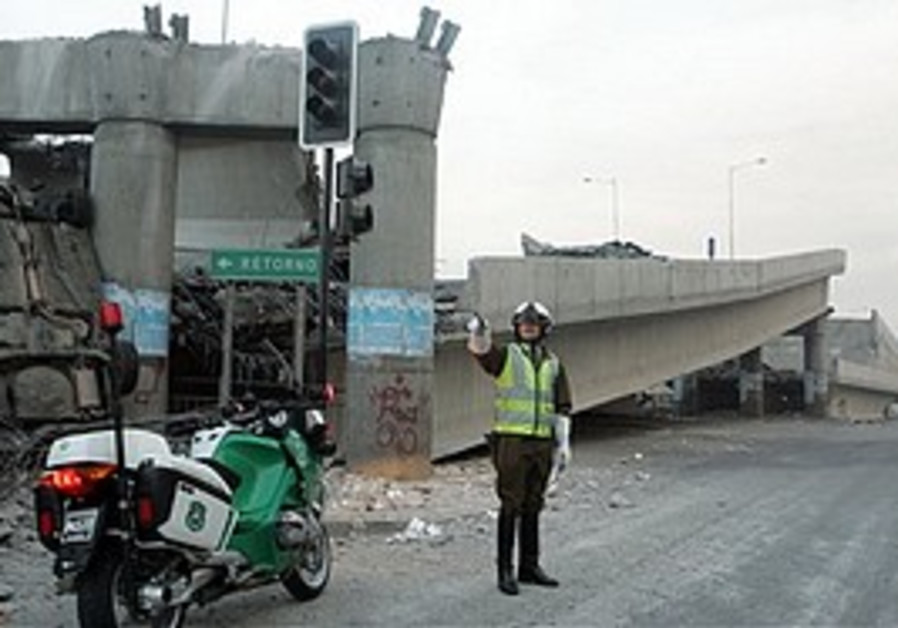 A police officer controls the traffic aside of an