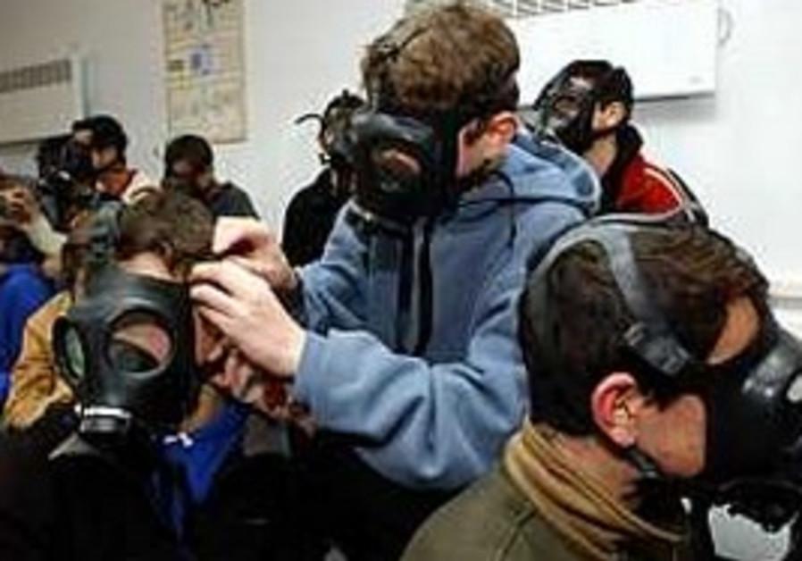 Pupils at a Jerusalem school don gas masks as part