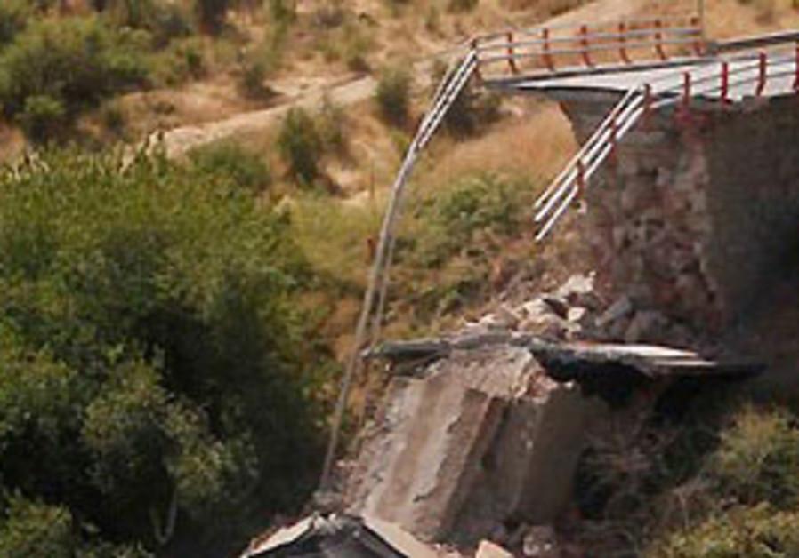 A collapsed bridge over the Claro river is seen ne