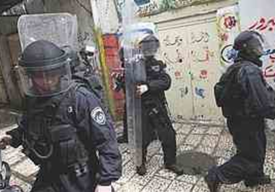 Police take positions during clashes with Palestin