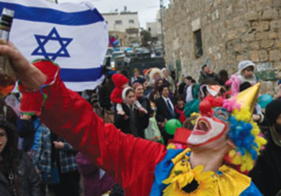 Settlers in costume murch in the annual Purim day