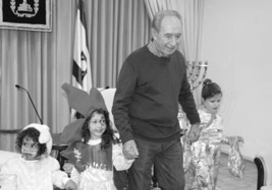 President Shimon Peres with celebrates Purim with