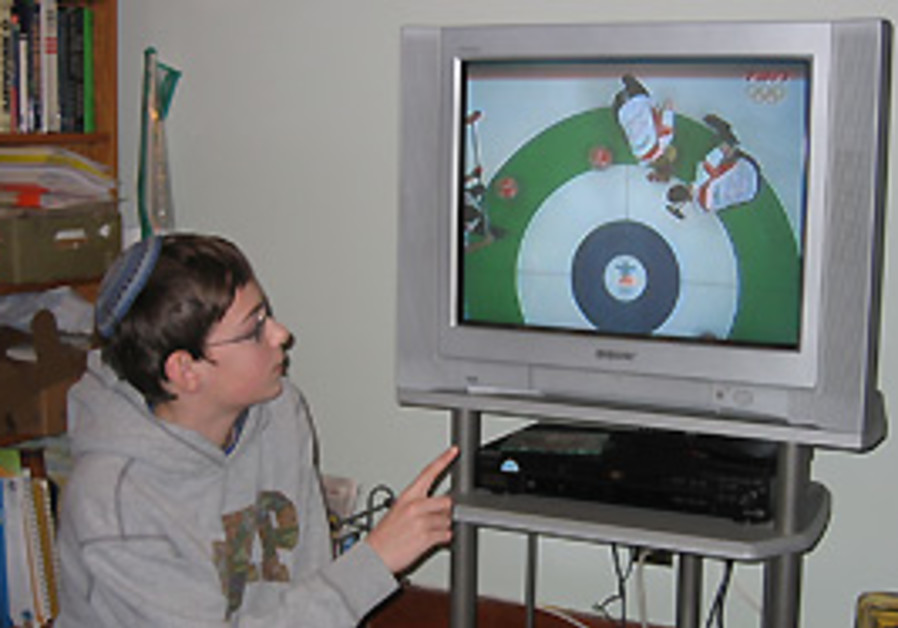 11-year-old Shmuel Hart explains about curling.