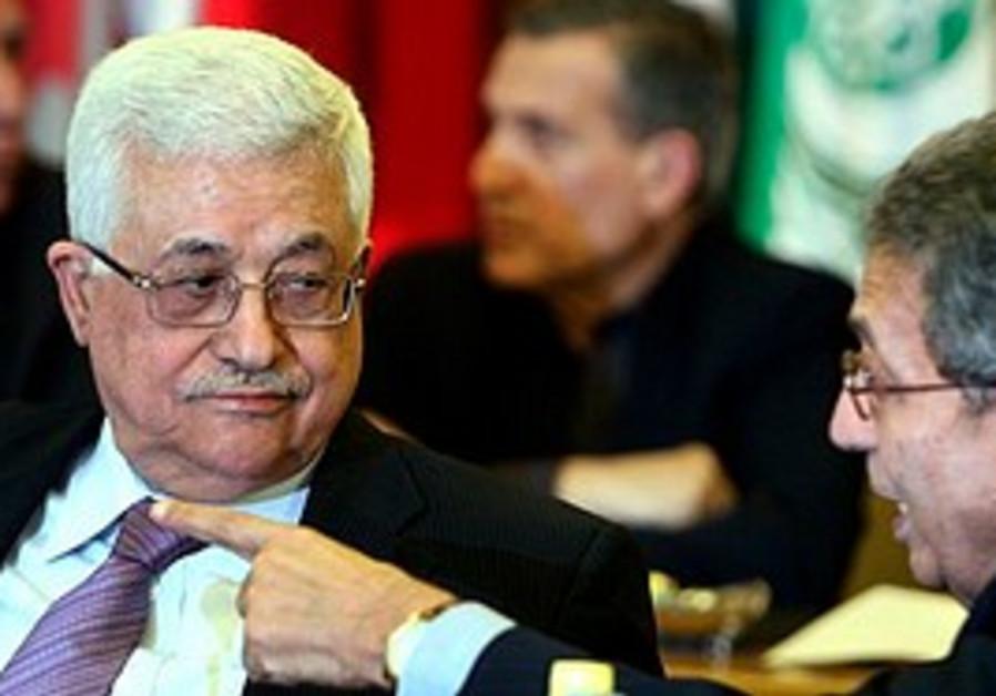 Arab League head Amr Moussa talks to Abbas at an A