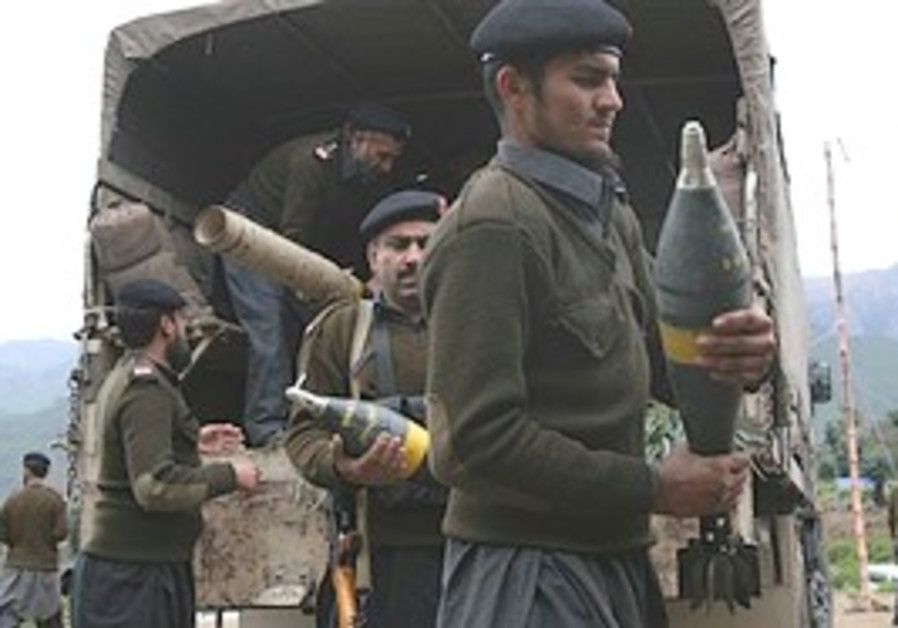 Soldiers of Pakistan's paramilitary force carry am