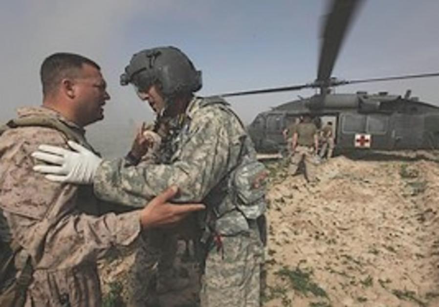 US soldiers evacuate two Afghan National Army sold