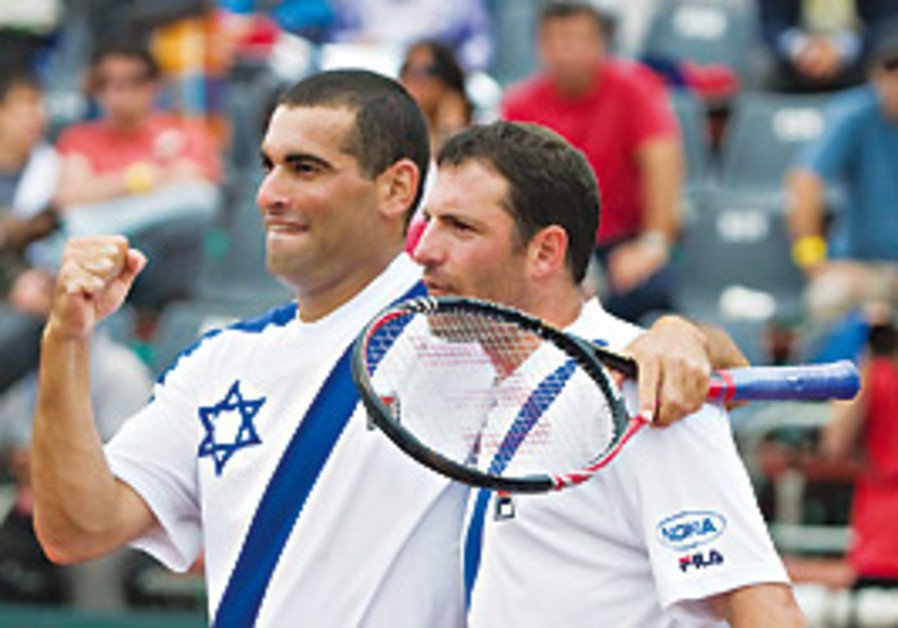 Andy Ram (left) and Yoni Erlich celebrate, Sunday.