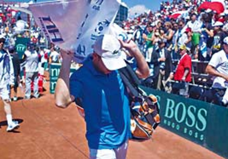 Dejected Sela leaves court in Chile