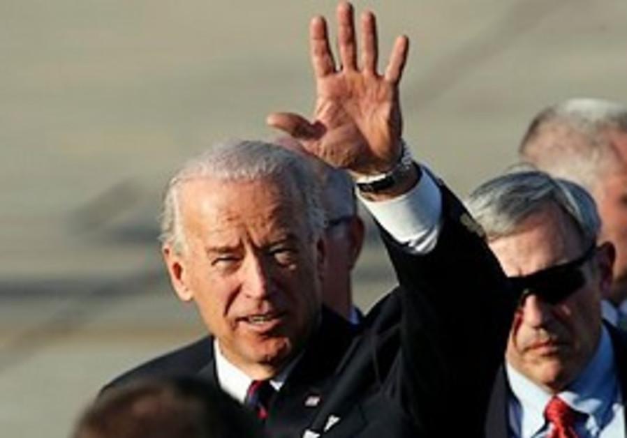 U.S. Vice President Joseph Biden, center, gestures