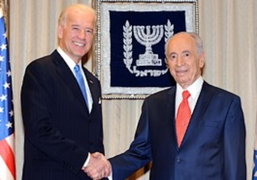 US Vice President Joe Biden shakes hands with Pres
