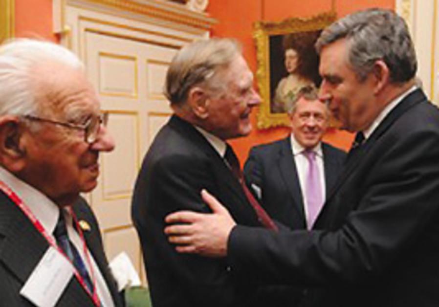 Gordon Brown greets Denis Avey at Downing Street a