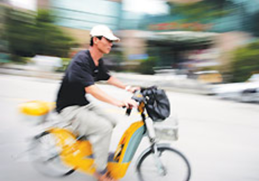 Commuters ride bicycles, mopeds and electric bicyc