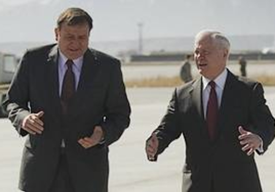 US Defense Secretary Robert Gates, right, talks wi
